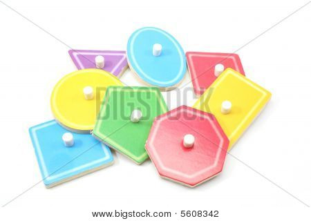 A nice display of children's puzzle shapes in a variety of colors. poster