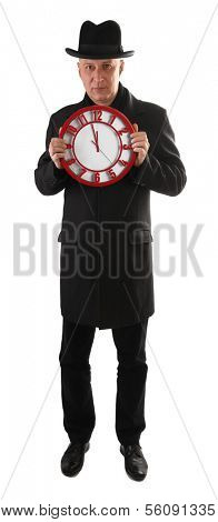 Man is holding clock and showing time