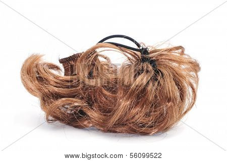 a brunette hairpiece on a white background