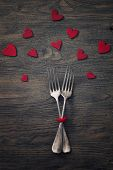 Restaurant series. Valentines day dinner with table setting in rustic wood style with cutlery poster