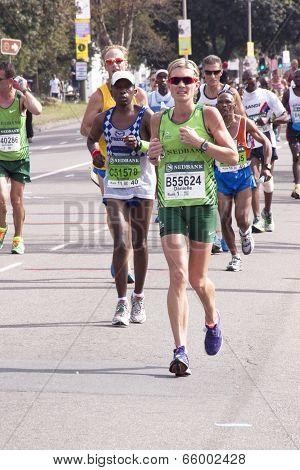 Woman In Green Running The Comrades Marathon