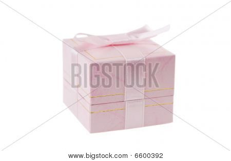 Close-up Photo Of Pink Gift Box Over White Background.