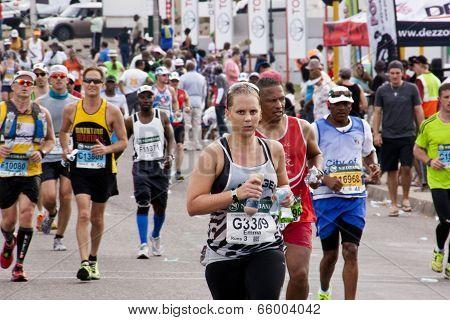 Determined Female Runner In Comrades Ultra Marathon