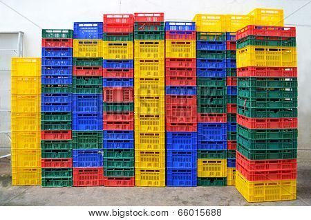 Colorful Plastic. Stacked Fruit Packing Containers.