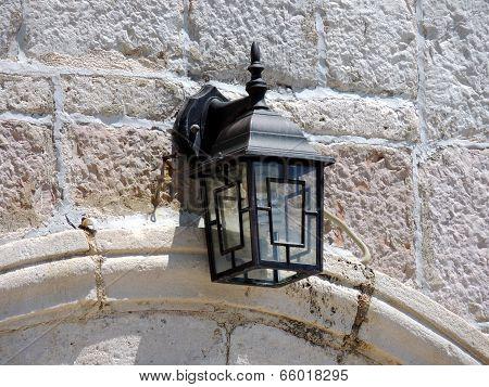 Lamplight On White Brick Wall