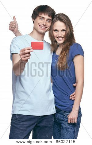 Happy couple with credit card