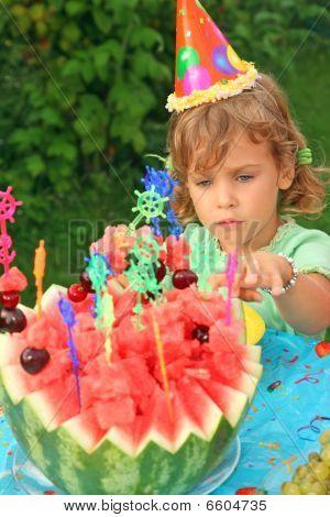 Little Girl In Cap Eats Fruit In Garden, Happy Birthday