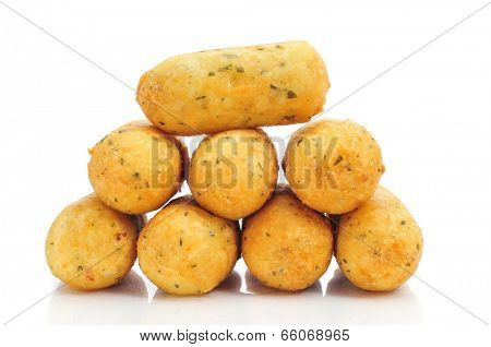 a pile of croquetas de bacalao, spanish codfish croquettes, on a white background