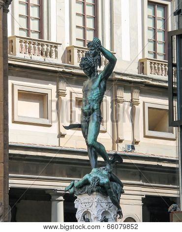 Perseus holding the head of Medusa. Statue by Benvenuto Cellini. Florence Italy poster