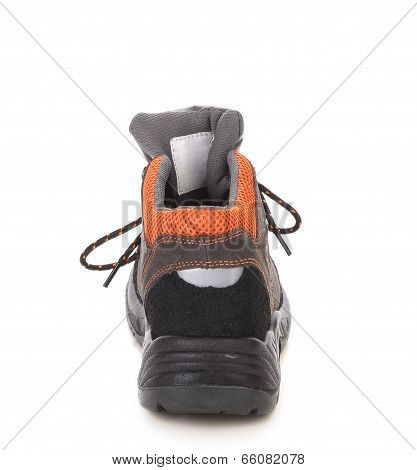 Black man's boot with orange inset.