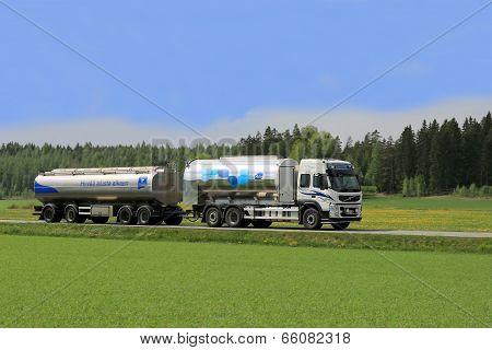Milk Tanker Truck On Scenic Summer Road