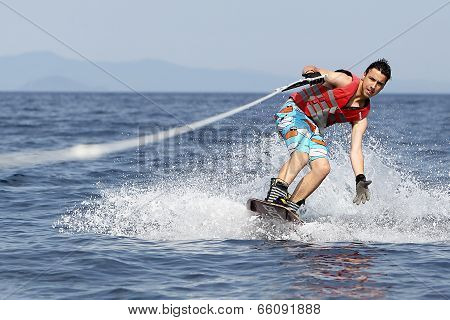 Unidentified Man Doing Water Ski On The Sea In Kallithea, Greece.