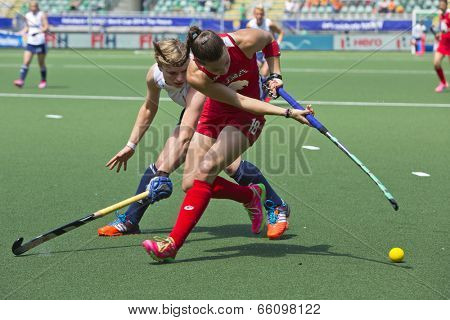 THE HAGUE, NETHERLANDS - JUNE 1: (GBR Richardson-Walsh and USA Kasold duelling for the ball during the Hockey World Cup 2014 in the match between England and USA (1-2) on June 1, 2014 in The Hague.