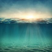 Abstract underwater background with sunbeams poster