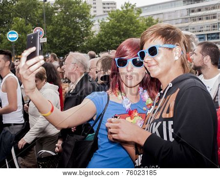 Elaborately Dressed Participants Taking Selfie, During Christopher Street Day Parade
