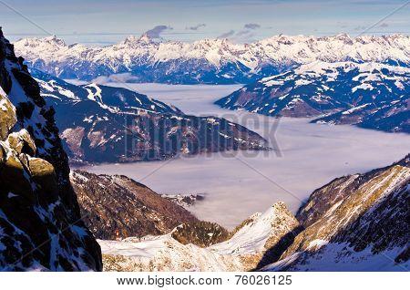 Foggy Zel am See valley from the top of Kaprun glacier in Austrian Alps