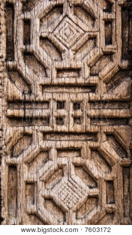 A Geometric Pattern Wooden Engraved Background