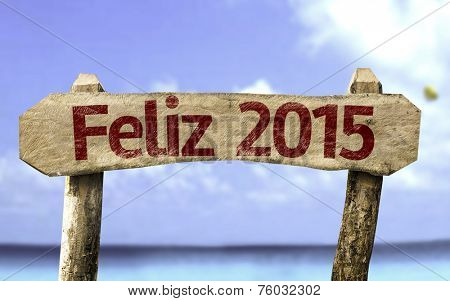 Happy 2015 (In Portuguese) sign with a beach on background