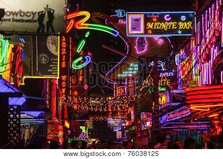 BANGKOK, THAILAND, JANUARY 31, 2012: View on the colorful neon lightings filling the Soi Cowboy street in the red entertainment district of Nana in Bangkok, Thailand