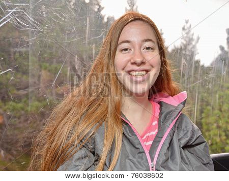 Portrait Of A Young Woman In A Cable Car