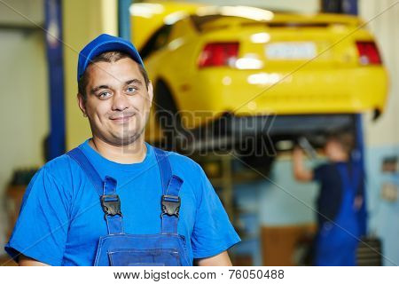 repairman auto mechanic Portrait in car auto repair or maintenance shop service station