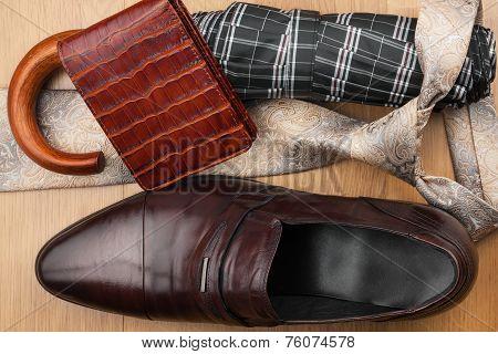 Classic Men's Shoes, Tie, Wallet, Umbrella On The Wooden Floor