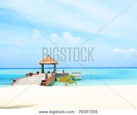 Overwater Villas In Blue Tropical Lagoon