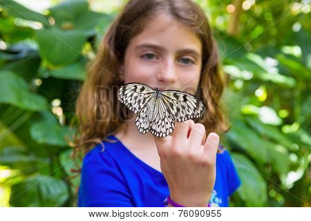 Girl holding finger Rice Paper butterfly Idea leuconoe in outdoor