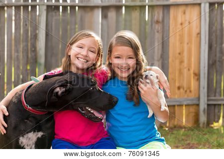 Twin sisters puppy pet dog and great dane playing together poster