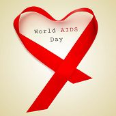 a red ribbon forming a heart and the text world AIDS day on a beige background poster