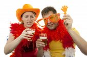 Two Dutch soccer fans in orange outfit cheering for the WK games over white background poster
