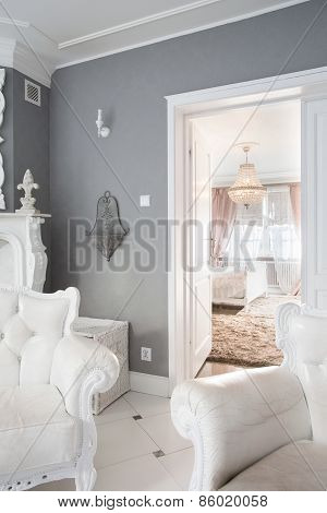 View of white furniture inside expensive house poster