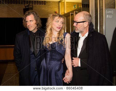 BERLIN, GERMANY - FEBRUARY 07: Director Brett Morgen, Courtney Love and Michael Stipe. 'Cobain: Montage of Heck' premiere. 65th Berlinale Film Festival at Kino International on February 7, 2015