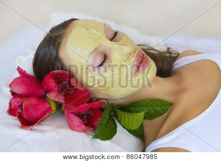 Spa Outdoor Beautiful young woman lying with natural Indian Multani Matti clay facial mask on her face skin care and wellness in tropical Thailand poster