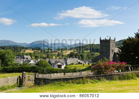 Hawkshead Lake District Cumbria UK beautful English village in summer with blue sky church and roses