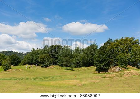Bowness on Windermere Lake District England UK golfers enjoying tourist attractions such as mini gol