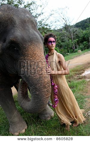 Fashion portrait of a model with an elephant. poster