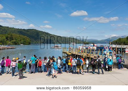 Bowness on Windermere Lake District England UK visitors enjoying tourist attractions