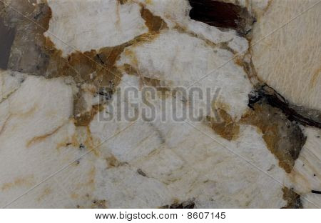 Surface Of The Granite. Pale Yellow And Reddish-brown Shades.