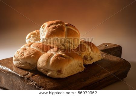 Stack of hot cross buns for Easter with creative lighting