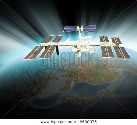 Satellite Orbiting in Space Above Earth