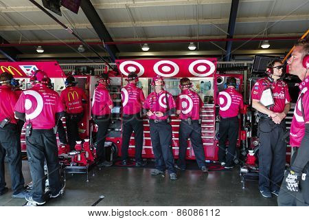 Fontana, CA - Mar 21, 2015:  The Target crew wait for their car to return during a practice session for the Auto Club 400 at Auto Club Speedway in Fontana, CA.