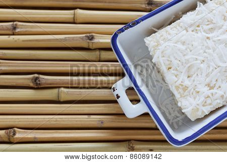 Brazilian Traditional Dessert: Sweet Couscous Pudding On Bamboo