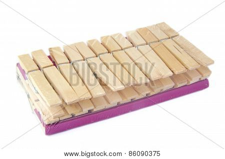 Set of new wooden cloth pegs or pins on a white background