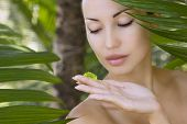 Beautiful caucasian woman holding natural aloe vera facial gel skin care and wellness. Facial moisturize mask spa salon outdoors. poster