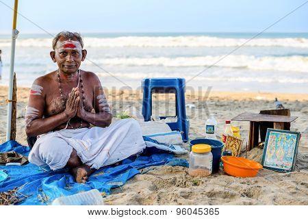 Varkala, India - February 22, 2013: Hindu Brahmin With Religious Attributes Sits In Namaste Mudra On