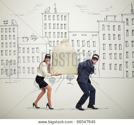 funny picture of happy couple of thieves carrying bag and looking at camera in drawing street