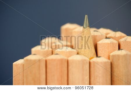Macro image of graphite tip of a sharp ordinary wooden pencil as drawing and drafting tool