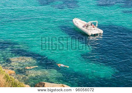 Modern Luxury Dinghy On Turquoise Sea With Clear Blue Water In Tropical Island - People Snorkeling