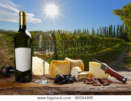 White wine accompanied by various cheeses.